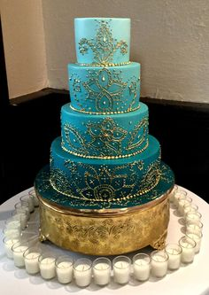 Gold Wedding Cakes Blue ombre Indian wedding cake with gold mehndi designs and a gold base makes for a modern but elegant Indian wedding cake Indian Cake, Indian Wedding Cakes, Cool Wedding Cakes, Wedding Cake Designs, Wedding Cake Toppers, Quirky Wedding, Trendy Wedding, Gold Wedding, Indian Weddings