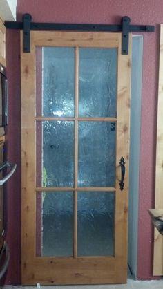 Barn door to laundry room.