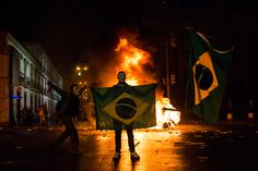 A demonstrator holds a Brazilian flag in front of a burning barricade on June 17 during a protest in Rio de Janeiro , Brazil. Pancho Villa, Brazil World Cup, World Cup 2014, Guy Fawkes, Brazil Protests, Brazilian People, Political Reform, Gil Scott Heron, Iconic Photos