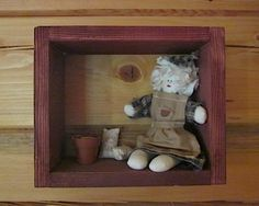 Easy, cute shadow box.  I used a doll and some accessories, but you could put anything in these open frames of wood.