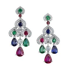 Set in 18 carat white gold with round white diamonds, pear and round rubies, sapphires, and emeralds.  Veranda.com (=)