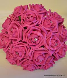 Hot pink rose bridesmaid posy - artificial wedding flowers in bright pink http://www.thebridesbouquet.co.uk/Rose-Bouquets.html
