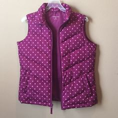 Lands End polka dot puffer vest size Small Warm and comfy vest from Lands End. Does have one minor spot that I'm pointing to in the picture.  It's really not that noticeable. Features 2 pockets with snaps. Lands' End Jackets & Coats Vests