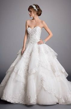 Eve Of Milady Sweetheart Ball Gown in Beaded Lace This ball gown features a sweetheart neckline with a dropped waist in beaded lace and organza. It has a chapel train.   Style Number:32860686 Price:$$$ ($5001-$8000)