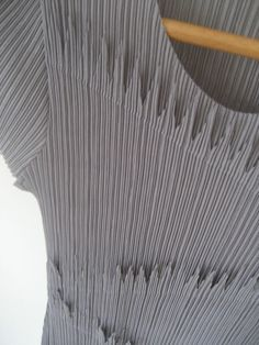 Spike detail on a top from Pleats Please by Issey Miyake.  From UK Ebay store Sugar Linnett (http://stores.ebay.co.uk/Sugar-Linnett)  August 2012