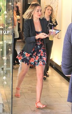 So chic: The 29-year-old cooled down with an iced tea as she made a dash in coral sandals, also sporting a black blazer