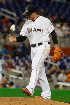 Jose Fernandez Photos - Starting pitcherJose Fernandez #16 of the Miami Marlins pauses between pitches against the Milwaukee Brewers at Marlins Park on May 9, 2016 in Miami, Florida. - Milwaukee Brewers v Miami Marlins