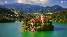 Bled is located on Lake Bled in Slovenia, with the magnificent Julian Alps in the background. Description from traveldrinkdine.com. I searched for this on bing.com/images