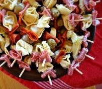 Antipasto skewers...great appetizer before Christmas dinner.  Mine will have marinated olives, artichokes, mushrooms, fresh mozzarella, and salami. Yum!