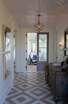Coastal Living Sullivan's Island Home Tour, design by Jenny Keenan and custom-painted floor by Suzanne Allen Studio | coastalliving.com