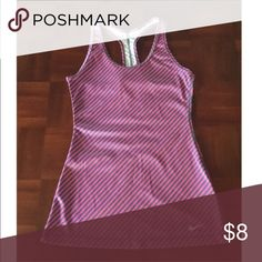 ❌FINAL PRICE❌Nike tank Gray and pink racer back tank...different striped patterns in front and back...a small blemish on top strap, but not a hole (see pic)...please note that this is a fitted tank and it fits snug...may work better as an XS or for someone with a smaller chest! Nike Tops Tank Tops