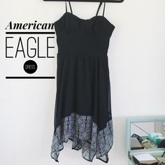American Eagle Dress NWOT American Eagle dress in perfect condition. It's so cute with frayed ends & corset like top. Perfect for spring/summer and the colors are beautiful! American Eagle Outfitters Dresses Mini
