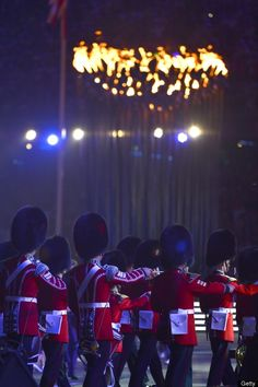 Guards march before the Olympic Flame during the closing ceremony of the 2012 London Olympic Games at Olympic Stadium in London