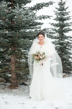 Our beautiful bride held a wintery bouquet of pink and champagne coloured roses, ivory hypericum berries, scabiosa pods and mixed winter foliage.  Photo: @oneedition   www.flowersbyjanie.com  #winterwedding #quicksandroses #Canmorewedding #Canmoreweddingflorist #winterbride #Calgaryweddingflorist #FlowersbyJanie