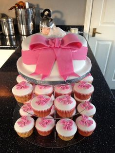 Baby girl christening cake and cupcakes