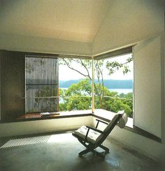 An internal veranda - a corner window solution with a deep sill and sliding timber screen.
