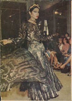 1976-77 - Yves Saint Laurent Couture show vintage designer fashion style 70s shiny lame long gown full skirt peasant ethnic runway show black blue grey novelty print metallic