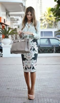 a light green blouse paired with a baroque print pencil skirt & styled with nude platform pumps, a grey satchel & a blue statement necklace