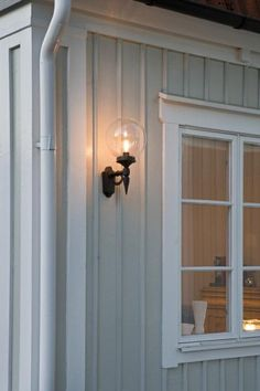 Clear spherical shade on black finish stand outdoor wall light. rated for protection from water, from Lighting Styles. Outdoor Wall Lighting, Exterior Lighting, Outdoor Lamps, Black Wall Lights, Garden Cabins, Front Door Porch, Wall Mounted Lamps, Wall Lantern, Glass Globe