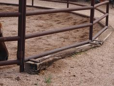 Heavy Duty Pipe Round Pen with secured Rail Road Ties around the outside to keep sand from pushing out.