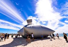 norton flavel inflates massive wine cask bag on australian beach