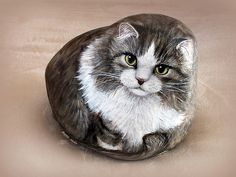 Cat painted on rock by Yvette