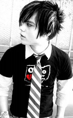 This photo shows another style of male Emo. Dark colors, weird colored neck tie. Unique hair style and color.