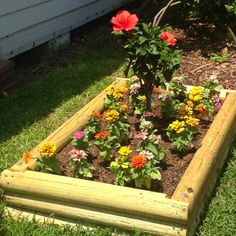 add lots for rocks to the flowerbed put a tarp underneath so