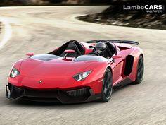 The Lamborghini Aventador J on the open road, note the helmet the driver is wearing, probably a good idea.