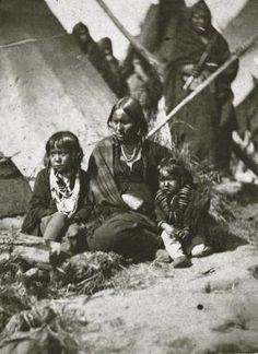 Little Crow's wife and two children at the Fort Snelling concentration camp.