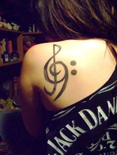 Tattoos? YES! Treble AND Bass clefs? YES! Jack Daniels?! YES YES YES!  Wait...this is about the music, but could this picture exemplify who I am any more? Probably not!