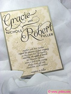 Capturing the exquisite elegance of French lace, this wedding invitation is designed in gold and beige with black script....