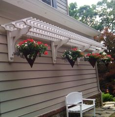 Trellis overhang with hanging baskets