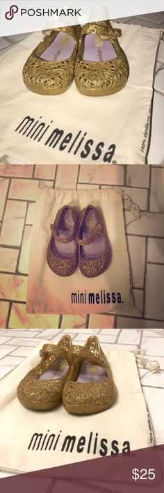 2 Pairs of Mini Melissa MaryJane style shoes Listing is for 2 pairs of size 6, Mini Melissa shoes. Gold: mini-Melissa+Campana and Mini Melissa Ultragirl Kitty shoe. Both are in excellent used condition. These are an essential for every mini fashionista! Fabulous condition and super comfortable. Your daughter will love wearing these. Comes with 1 dusbag. Price firm unless bundled.  MELFLEX™ PVC is durable, flexible, hypoallergenic and recyclable. Made in Brazil Mini Melissa Shoes Baby…