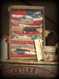 """Old Wood Post Office Box With Folded Antique Calico Quilt Pieces Approx. 9"""" tall and 5"""" wide $45.00"""