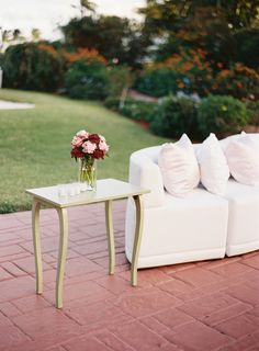 seating area, graceful table, pretty color flowers