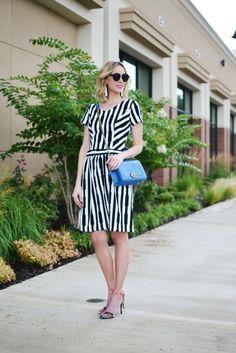 mikarose black and white dress, floral heels, white tassel earrings, blue bag