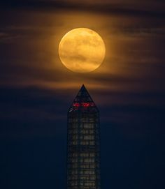 A supermoon climbed its way to the top of the Washington Monument, Sunday, June 23, 2013, in Washington in this photo by NASA photographer Bill Ingalls. This year the supermoon is up to 13.5 percent larger and 30 percent brighter than a typical full moon is. This is a result of the moon reaching its perigee %u2014 the closest that it gets to the Earth during the course of its orbit. During perigee on June 23 the Moon was about 221,824 miles away, as compared to the 252,581 miles away that it…