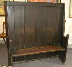 """A """"settle"""" bench - English 18-19th century...  They set it in front of the fireplace and the high back holds the heat in around you!"""