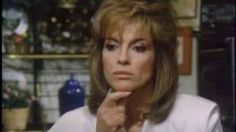 Dallas: JR and Sue Ellen kitchen kiss, via YouTube.