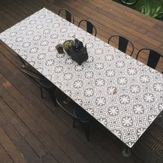 Custom Moroccan tiled table top with plumbing piped legs made by Lionandtheleek