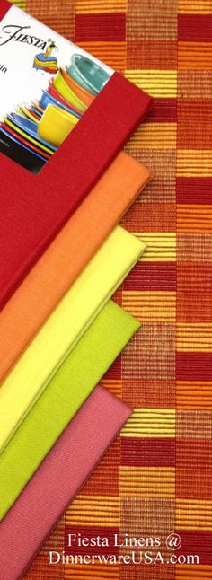 Plaid Fiesta Placemats and matching colors - This is a great autumn ensemble - napkin colors include Scarlet, Tangerine, Sunflower, Lemongrass and Flamingo (yes there is Flamingo in here - but it is the weakest color) Found in Linens section of http://DinnerwareUSA.com