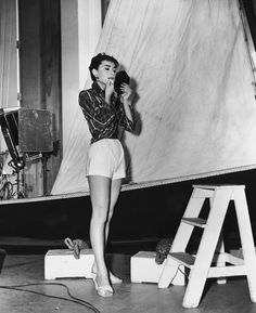 Audrey Hepburn (1929-1993) adjusts her make-up off the set of ' Sabrina' (aka ' Sabrina Fair'), directed by Billy Wilder. Description from gettyimages.com.au. I searched for this on bing.com/images