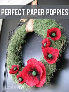 Love these Perfect Paper Poppies on a Wreath for Spring!! I'm surprised at how easy they were to make too! Full tutorial at howdoesshe.com #poppies #diy #wreath