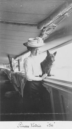 Princess Victoria with Mac on board the 'Victoria and Albert III'. 1909.