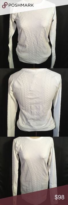 Lululemon White Rest Less Pullover Size 6 This top is BEAUTIFUL! It's only been worn once and in amazing condition with no stains. The rip tag is still attached as well. The last photo is to show just to show the fit and style (I believe that is the gray or silver color). Comes from a smoke free home lululemon athletica Tops Tees - Long Sleeve
