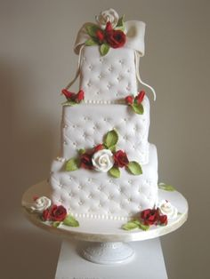 Quilted Wedding Cake. I like the quilted look but not the flowers they used.