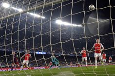 Barcelona's Argentinian forward Lionel Messi (L) scores a goal during the UEFA Champions League Round of 16 second leg football match FC Barcelona vs Arsenal FC at the Camp Nou stadium in Barcelona on March 16, 2016.