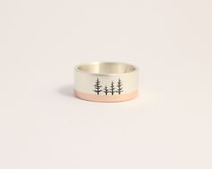 A couple of custom pines on one of lovely two-tone band in rose and white gold.