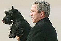President George W. Bush with his dog Barney.